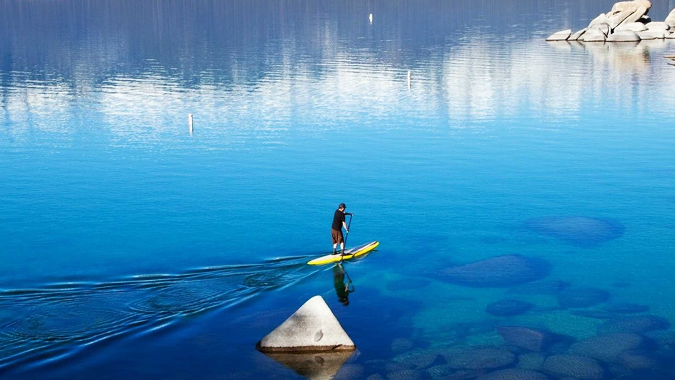 Paddle-boarding is a popular outdoor sport at Lake Tahoe.