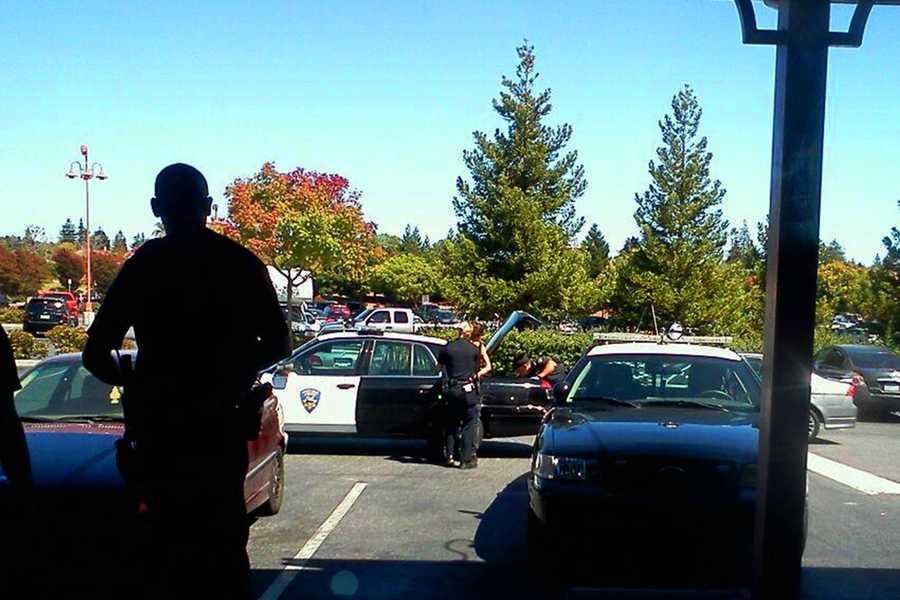Hawkins is seen here being handcuffed Aug. 26, 2013 on River Street in Santa Cruz.