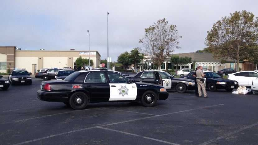 Police arrested an adult and a teen on Monday in connection with an attempted armed robbery at the Classic Coachworks automobile repair shop in Monterey.