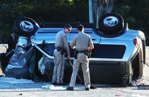Register Pajaronian photographer Tarmo Hannula shot this photo of a Mitsubishi that flipped during a crash on Highway 1 in Santa Cruz. CHP officers said the Mitsubishi's driver, David Fairbanks, 26, of Aptos, was drunk when he crashed. (Sept. 22, 2013)