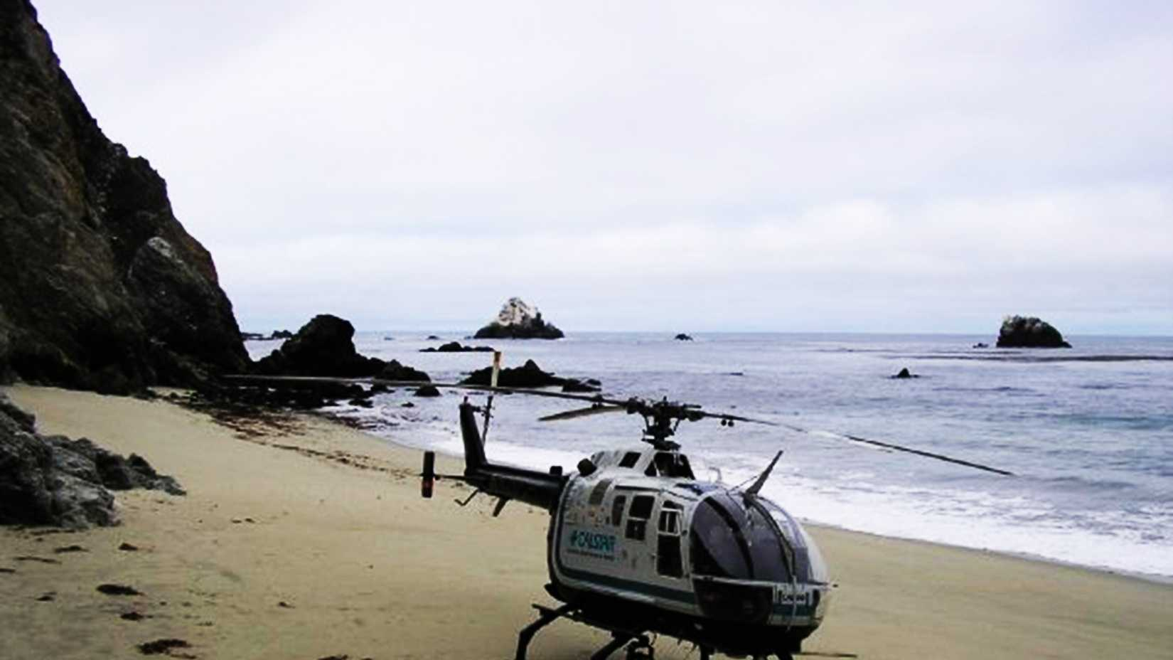 This CalStar helicopter had to land on a Big Sur beach under the Bixby Bridge.