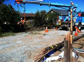 The danger of the situation was compounded because the out-of-control vehicle also knocked down two power poles, ripped down live electrical wires, and caused a gas leak.