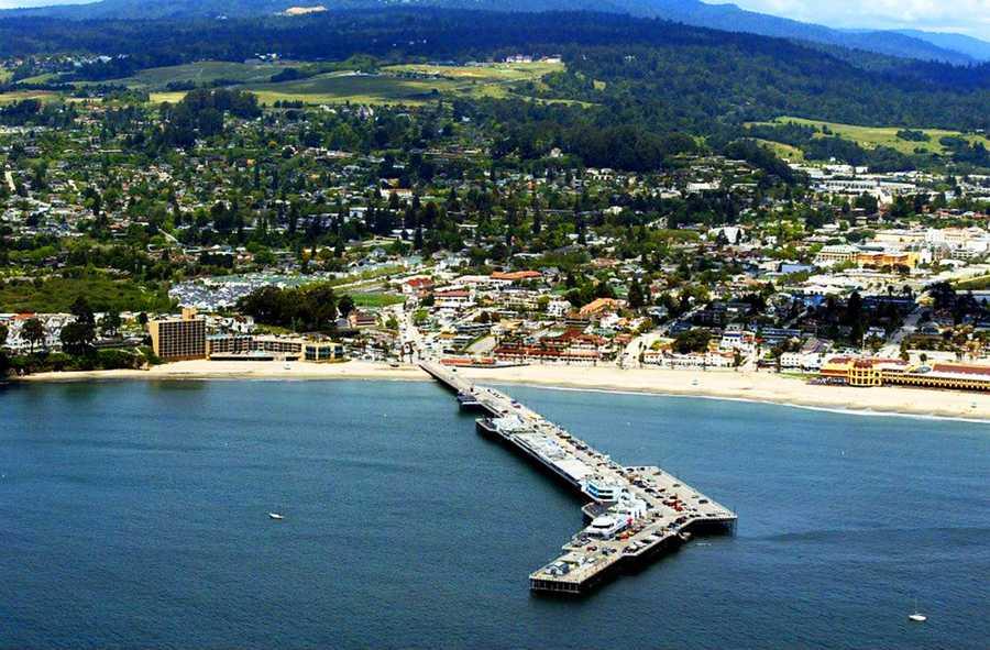 The Santa Cruz Municipal Wharf stretches from Main Beach's sandy shore into the ocean toward wave magnet Steamer Lane.