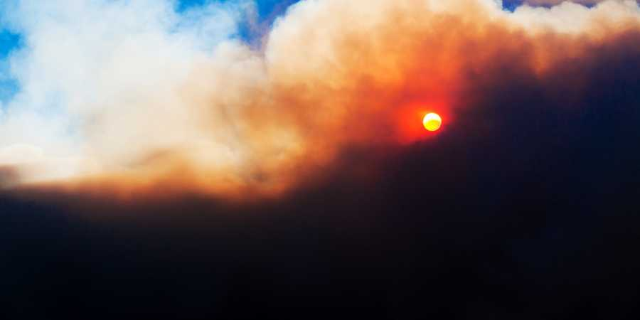 Monday's bright blue sky was suddenly covered by brown and orange smoke.