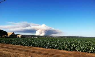 Smoke clouds are seen from Salinas Tuesday. (Oct. 15, 2013)