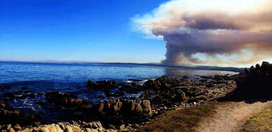 The Fort Ord fire is seen from the Pacific Grove recreational trail.