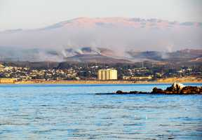 The U.S. Army's controlled burn at Fort Ord is seen form Lover's Point in Pacific Grove Tuesday in this photo by Ben Campbell.