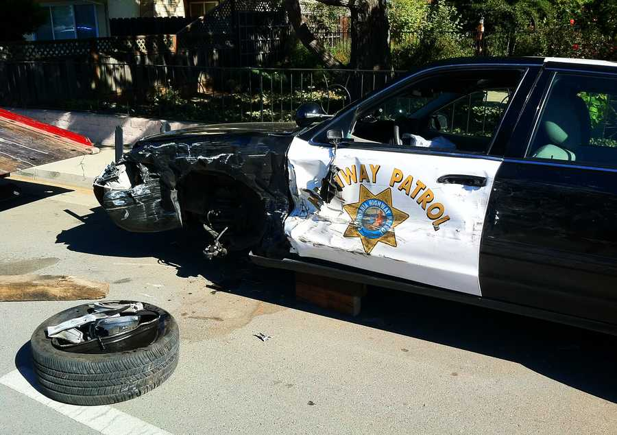 The truck's trailer eventually broke off and tumbled toward pursuing patrol cars. Officers threw spike strips across the grey pickup truck's path at 10 a.m. and all four of the truck's tires deflated.