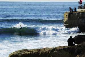 Santa Cruz surfer Shaun Burns, 21, won his first heat to the cheers of his homecrowd. / Photo by Ellis