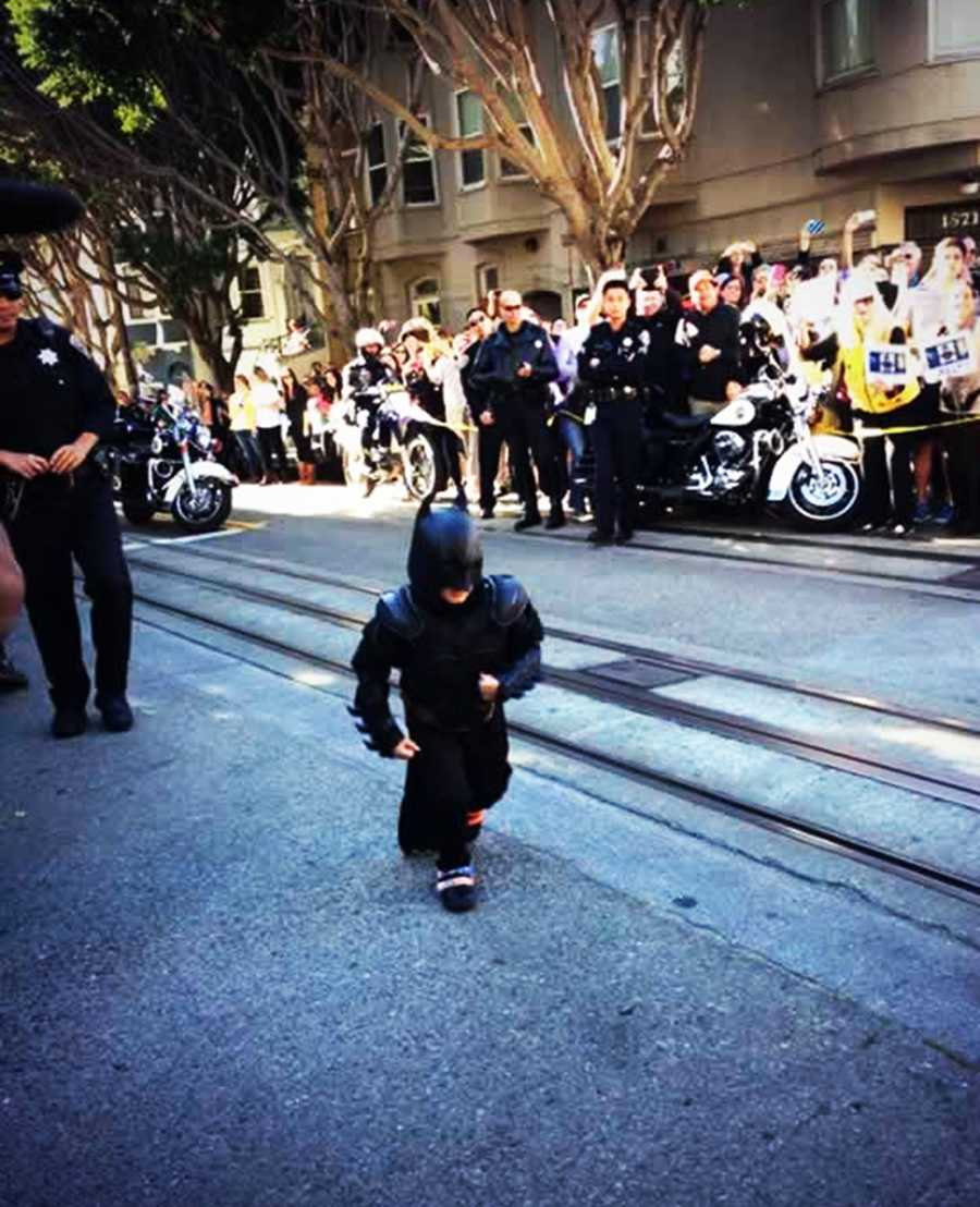 Thousands of San Franciscans jostled for space along the street to cheer on Miles.
