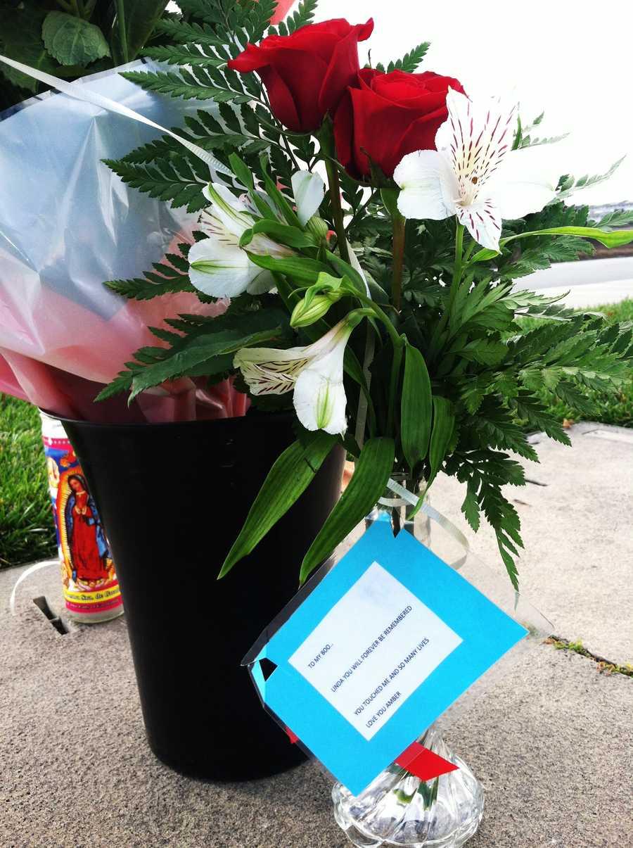 On Thursday morning, red roses, white irises, letters, and balloons were left where Linda Rascon died.
