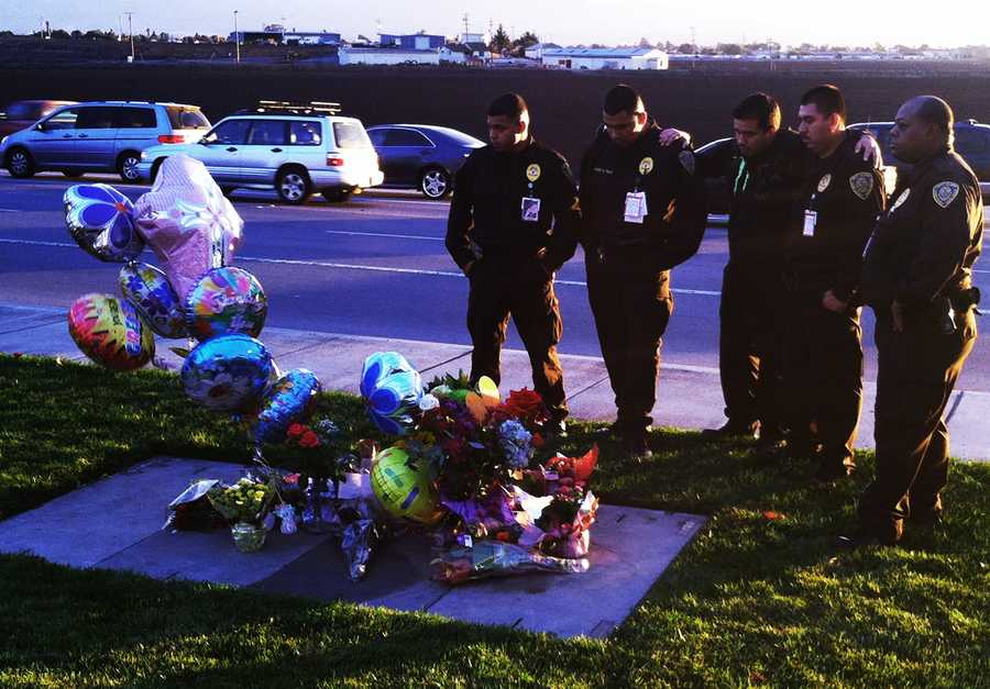 """Fellow First Alarm security guards gathered and cried at the growing memorial Thursday.""""She was a phenomenal officer and a model citizen. She was selfless in everything she did,"""" Theresa Larkin of First Alarm said."""