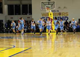 A local middle school basketball team played a quick full-court game during halftime.