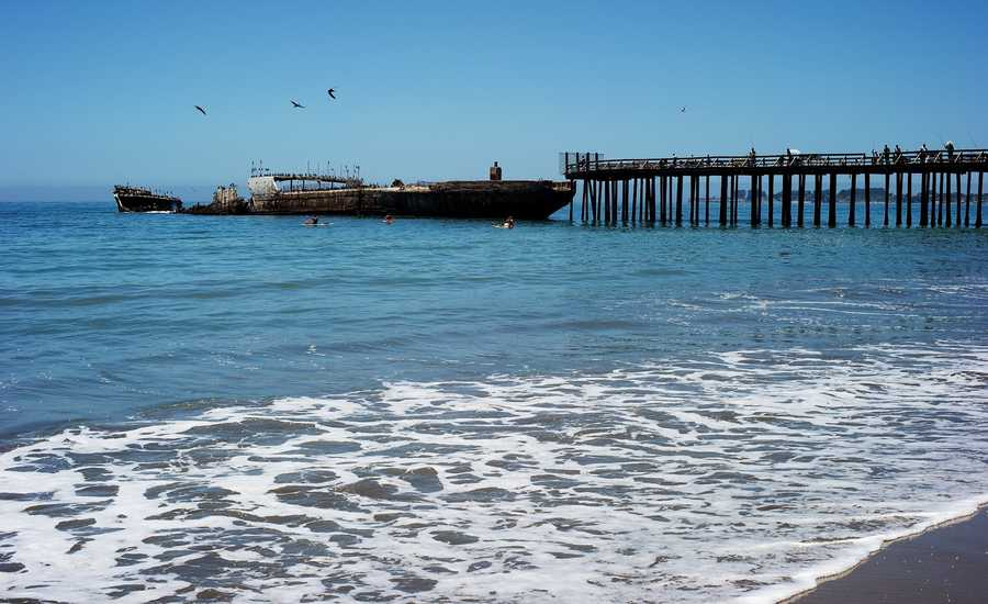 """A search and rescue team went inside a cement ship at Seacliff State Beach to look for a missing teenager. The concrete freighter locally known as """"the cement ship"""" is half-submerged in the ocean and pieces of its deck have crumbled away from battering waves. It's unsafe to enter and has been closed off to the public for decades."""