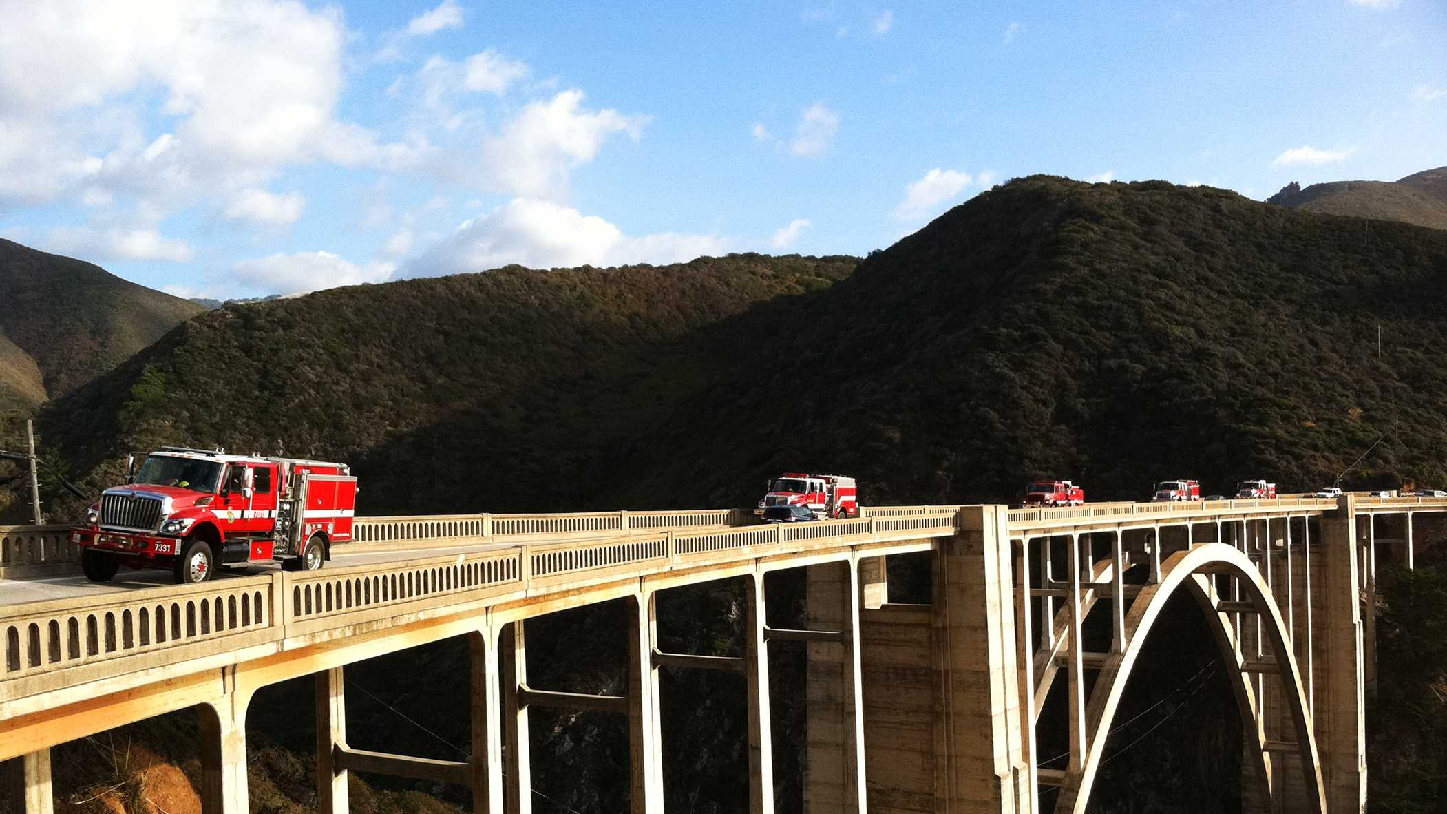 Firefighters are seen leaving Big Sur over the Bixby Bridge.