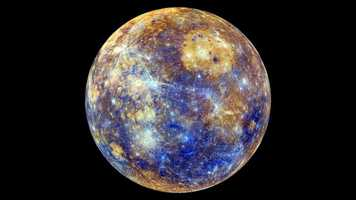 Colorful Mercury -  NASA's Mercury-orbiting MESSENGER spacecraft captured this dazzling false-color image.
