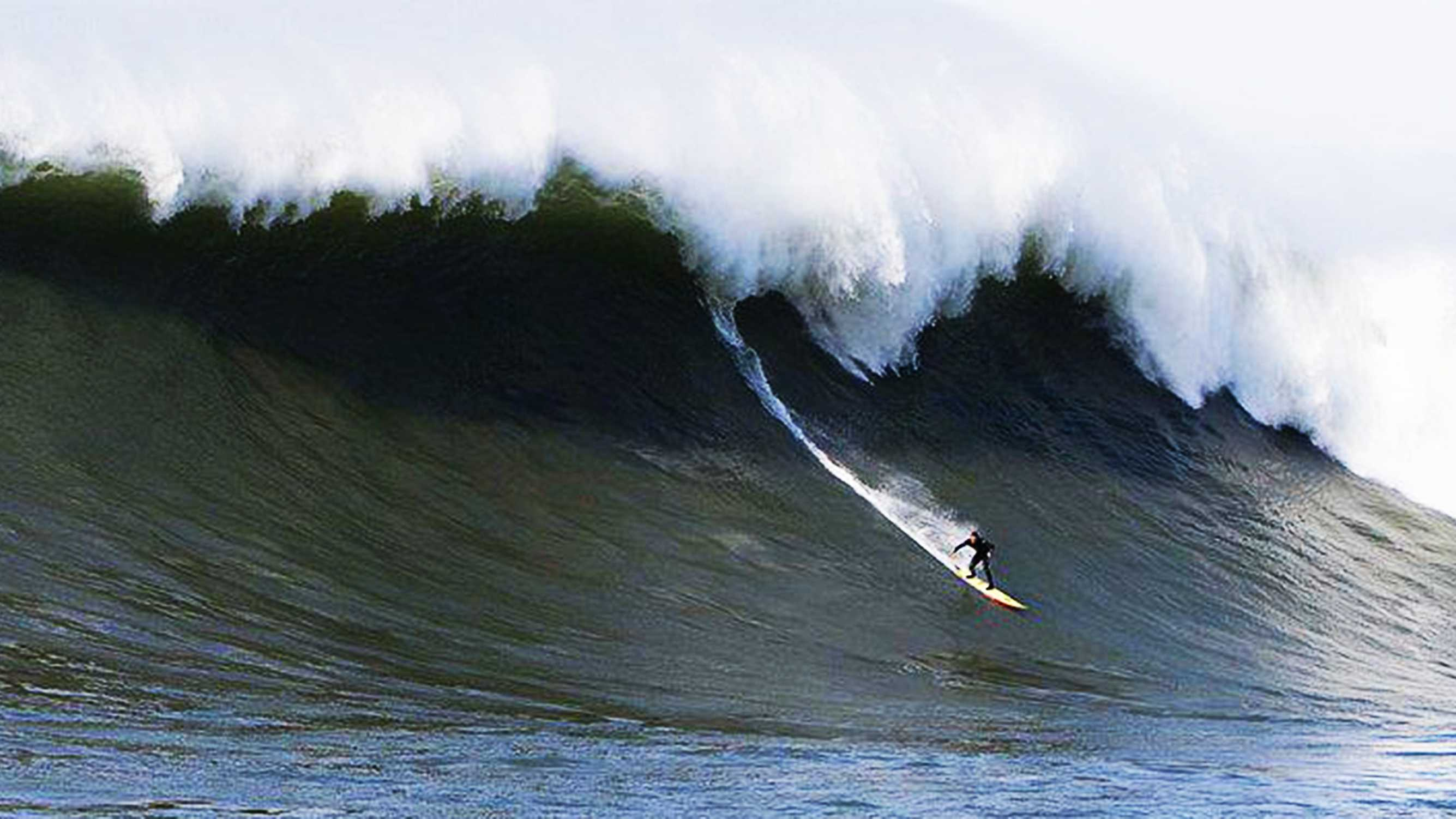 Shawn Dollar of Santa Cruz catches a 55-foot wave at Mavericks.
