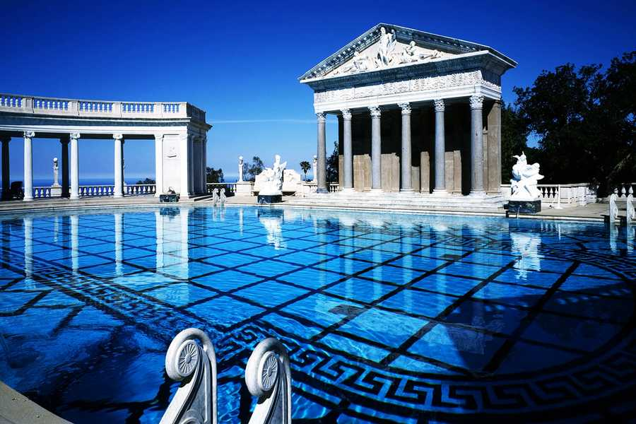 Synchronized swimmers performed in the castle's iconic outdoor Neptune Pool for Lady Gaga's music video.