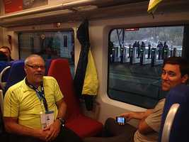 Thad and Bryce Sigourney on the train from the mountain cluster to the Olympic Park in Sochi.