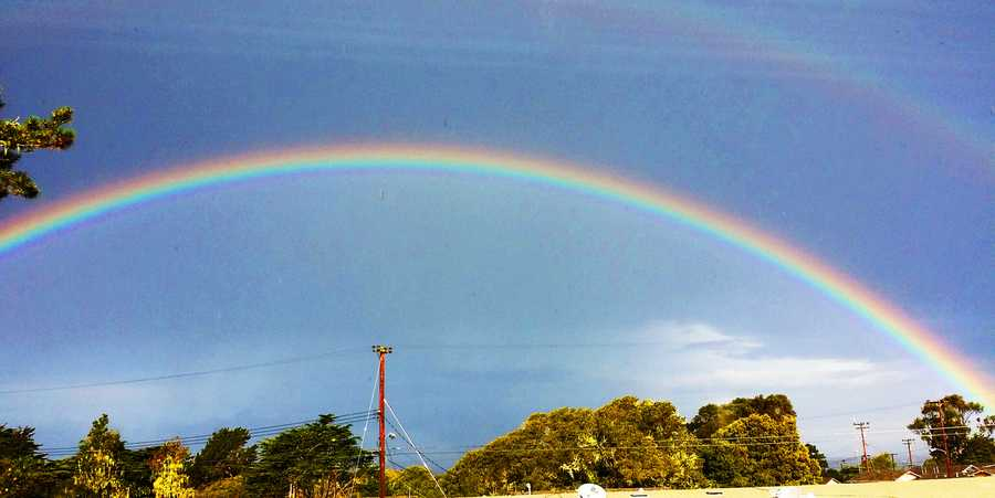 Some areas on the Central Coast had patches of sunshine. A rainbow arches over the former Fort Ord. (Feb. 28, 2014)