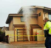 A blow hole spouted ocean water through a house's driveway in Sunny Cove in Santa Cruz off East Cliff Drive. There is an ocean cave under the house and the storm surge caused water to shoot out. (Feb. 28, 2014)