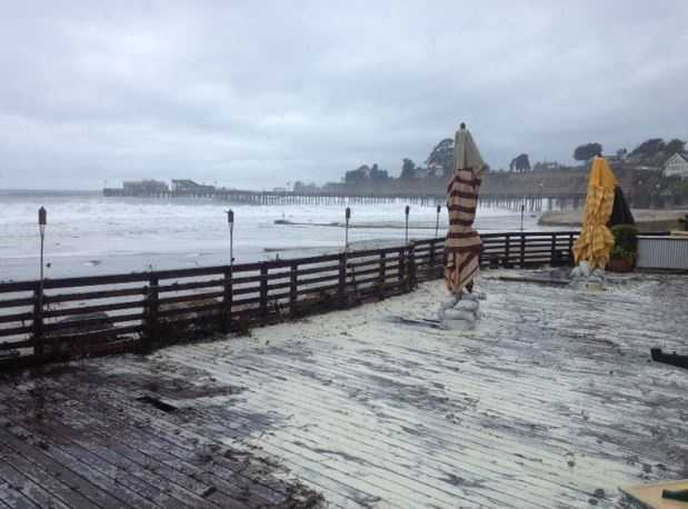 Water and sand spilled over Capitola Village on Saturday.