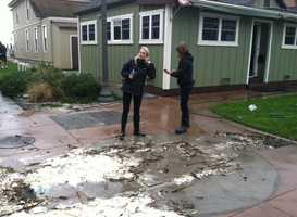 KSBW's Margot Dunphy prepares to do a report on the storm's impact on Capitola.