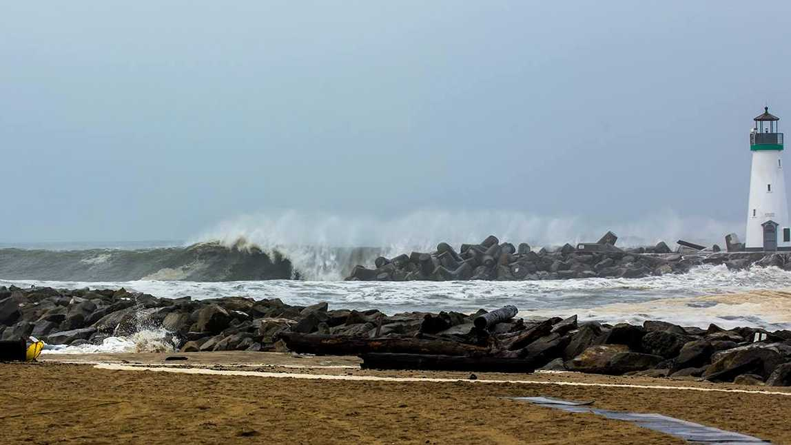 A wave blasts against the Santa Cruz harbor lighthouse on March 1.