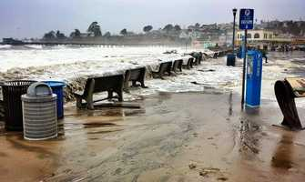 Ocean waves swept over Capitola Village during a storm surge on March 1. (Photo bySanta Cruz Waves / Sabine Dukes)