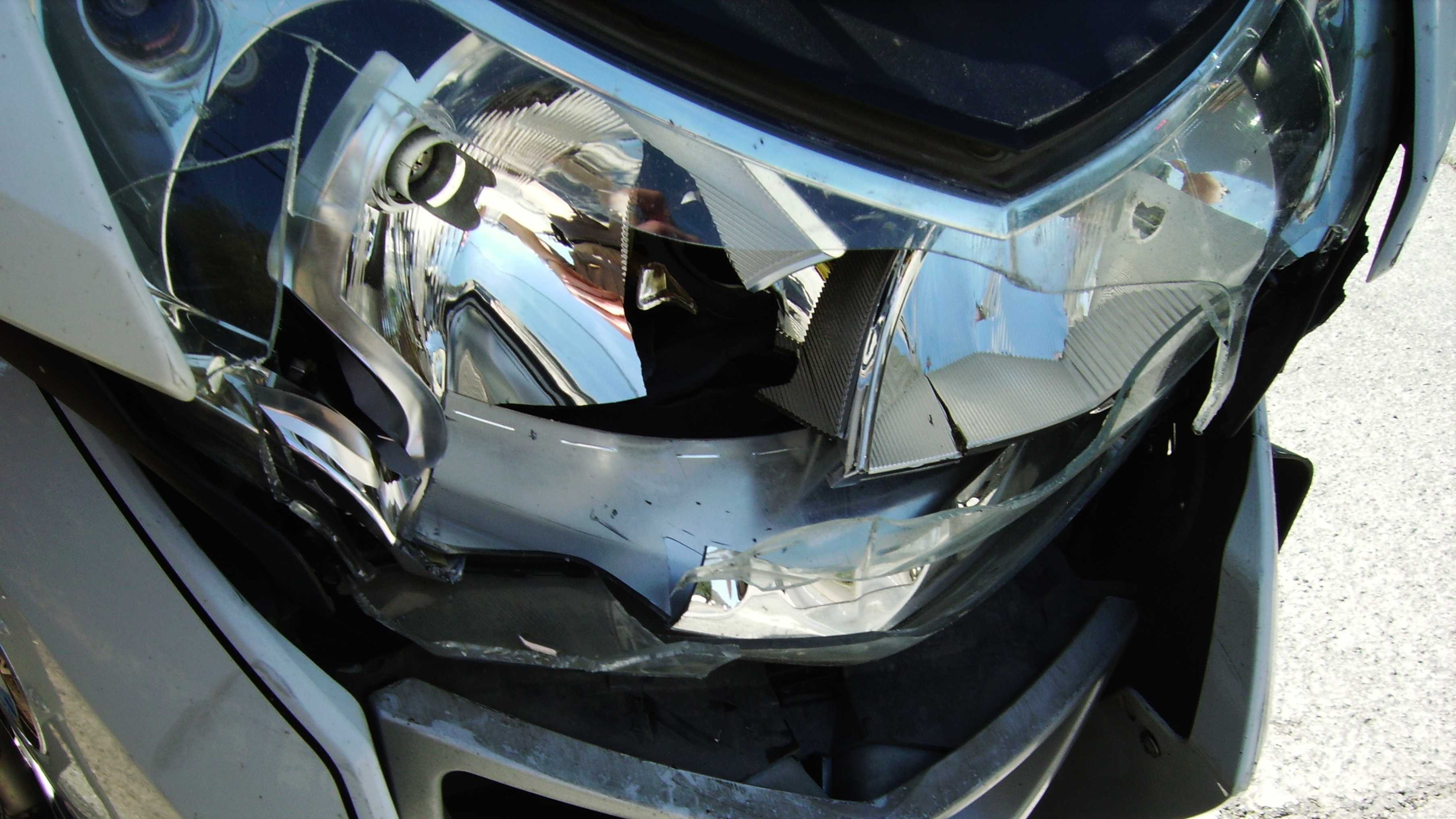 A CHP officer's motorcycle is damaged after she crashed.
