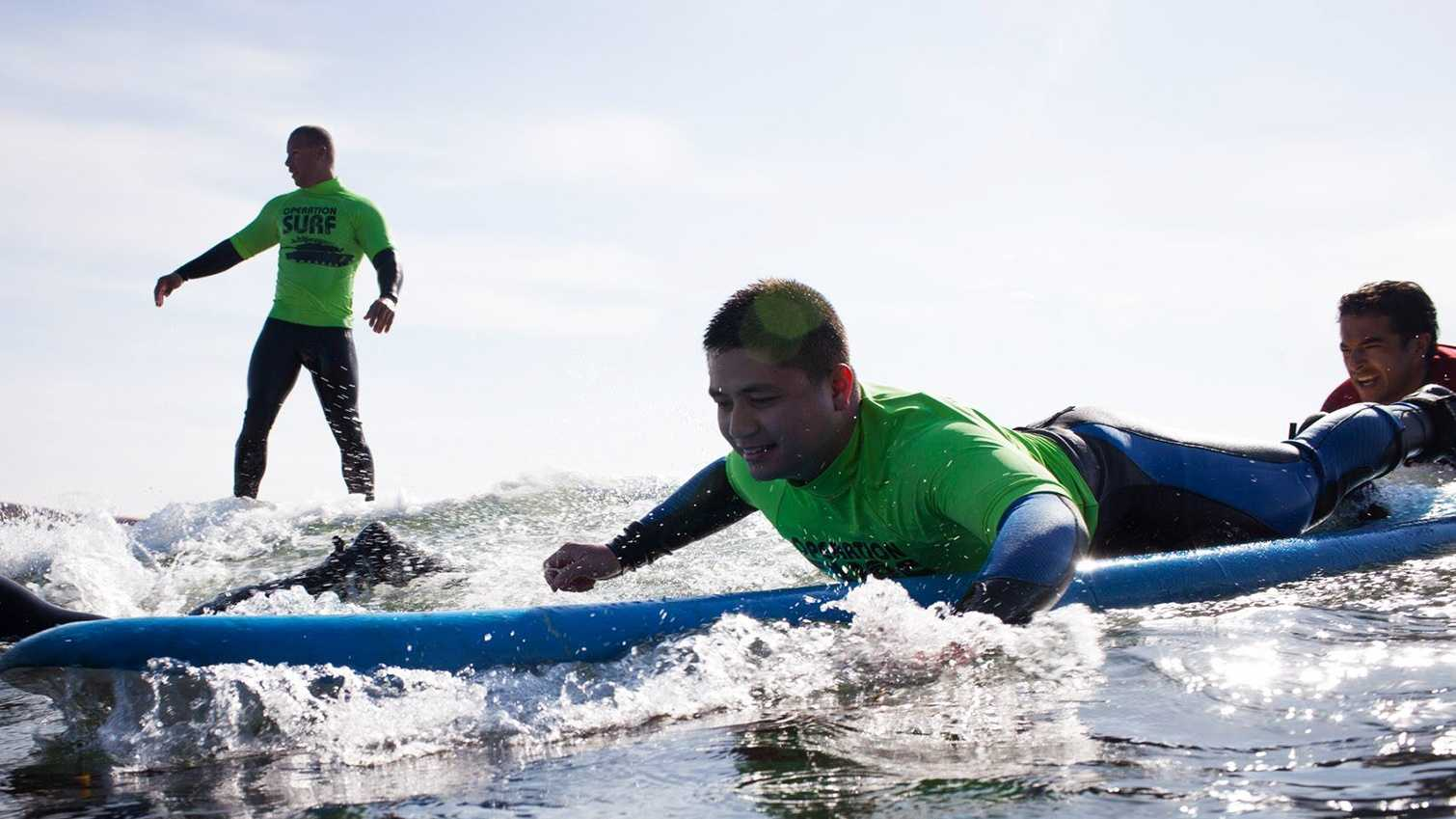 Wounded soldiers learn how to surf at Cowells Beach. (April 3, 2014)