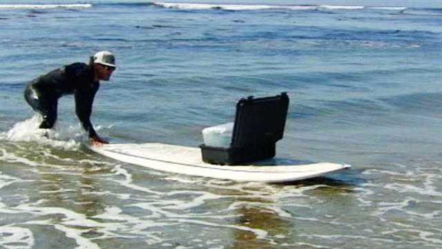 Tyler Fox collects ocean water samples at Pleasure Point in Santa Cruz.