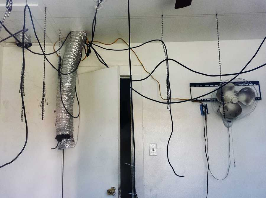 Electrical cords and an air vent are seen here hanging inside the Salinas weed house.  In the Greenfield house, growers had tapped into PG&E's main electrical grid, which allowed them to hide excessive power usage needed to power high-voltage light bulbs.