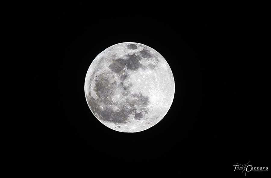 The moon is seen over the Santa Cruz mountains before it changed colors one night in April 2014.