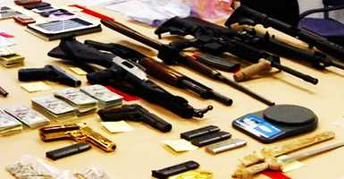 The following guns, ammunition, piles of cash, and drugs were found in his two homes in Seaside and Monterey.