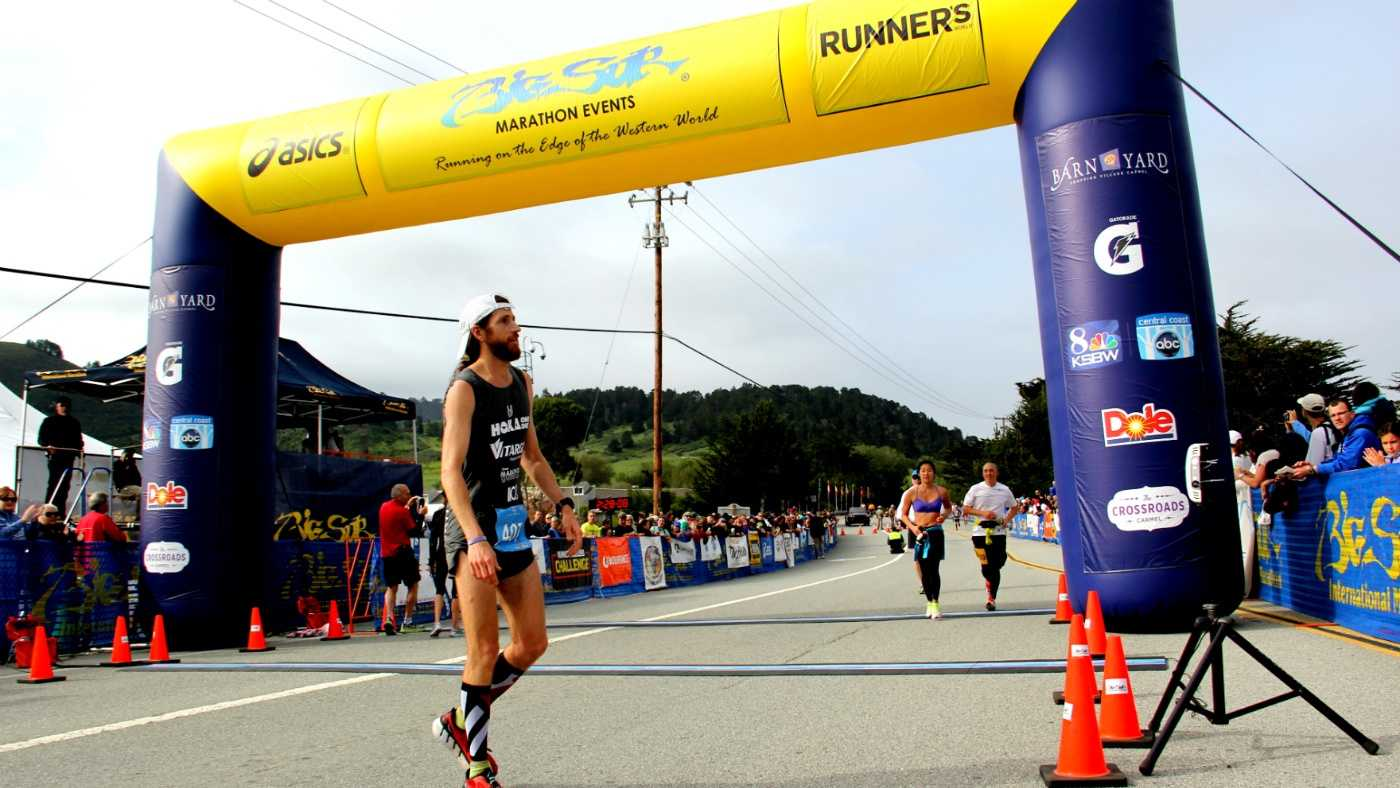 Michael Wardian catches his breath after winning the 2014 Big Sur International Marathon.