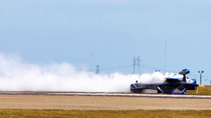 Roger Bockrath, a retired photojournalist, was taking pictures of the show and witnessed the crash. He said Andreini, flying into a sometimes gusty wind, passed on two attempts at the stunt before trying a third time, when he hit the tarmac and slid to a stop in an open field. (May 4, 2014)