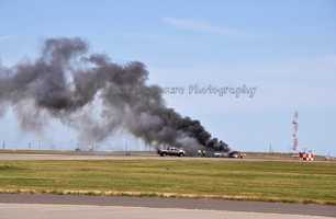 Bockrath said nearly 2 1/2 minutes went by before someone appeared with a fire extinguisher. By then, the aircraft was fully enflamed and collapsing from the heat. He said it took a total of five minutes before fire crews arrived. (May 4, 2014)