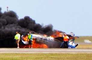 The plane was flying upside-down and low over the tarmac when it crashed and caught fire. (May 4, 2014)