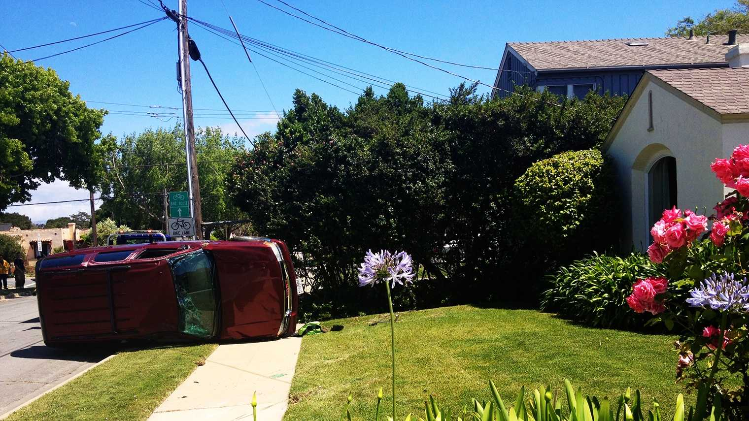 An SUV landed on a house's front lawn Tuesday.  (May 6, 2014)