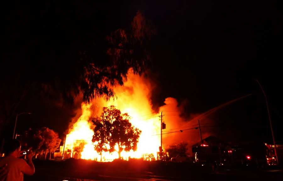 """""""It was like walking into hell. Flames surrounded us everywhere,"""" firefighter Richard Casteel said. (May 12, 2014)"""