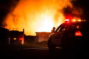 Flames fueled by thousands of cardboard boxes stored in a Robert Mann Packaging lot in Watsonville jumped 60 feet into the air and burned out of control until 4 a.m. (May 12, 2014)