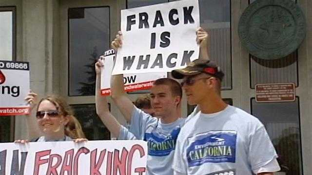 "A sign reads, ""frack is whack."""