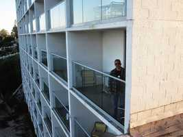 Hudson, Martinez, and Antwine dashed onto their balcony and jumped onto the hotel's rooftop to escape, Clark said.