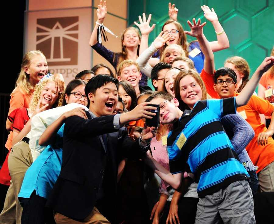 """Spellers posed for a group selfie on stage! The fun photo was perfectly acceptable to these smart kids, especially since """"seflie"""" was added to the dictionary as a real word in 2013. They called this shot a """"spellfie!"""""""