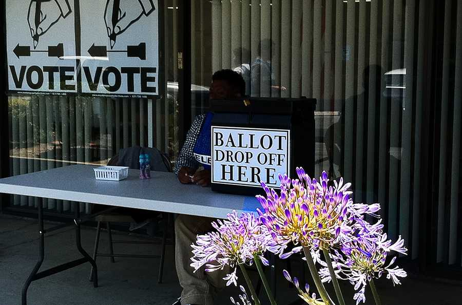 An election worker waits for voters to arrive in Salinas.