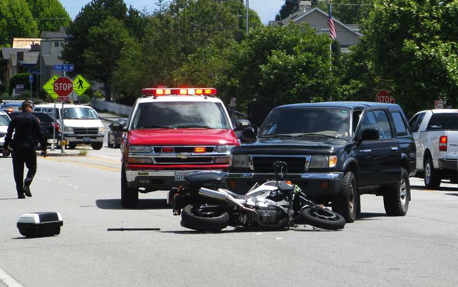 (June 3, 2014) A Capitola police officer was riding a motorcycle and had just arrived at a crash scene to help an injured pedestrian when someone driving a pickup truck crashed into the officer.