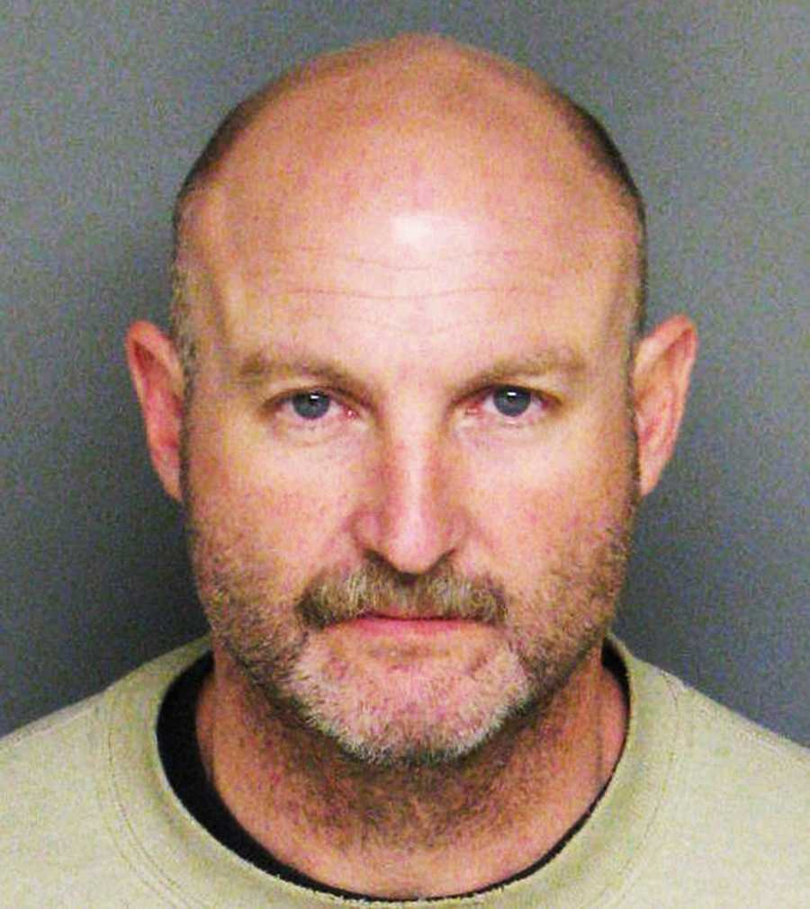 Sgt. Mark Baker was accused of making threats. He pleaded no contest to false imprisonment.