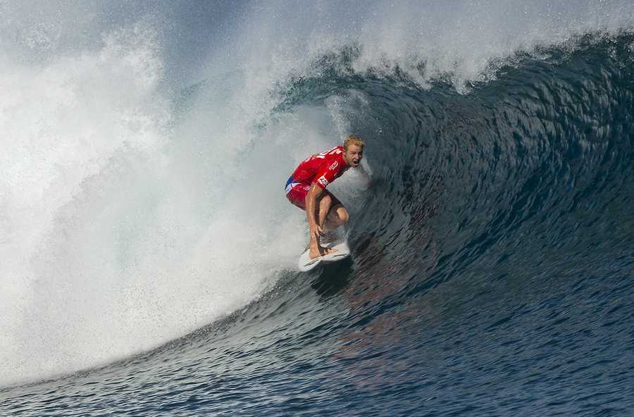 Young is seen here surfing in the final of the Fiji Pro.