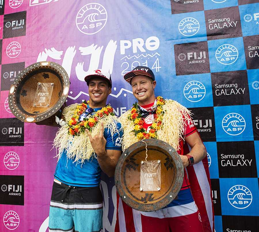 Nat Young, a 22-year-old surfer from Santa Cruz, celebrates with his 2nd-place trophy at the Fiji Pro on the ASP World Championship Tour. (June 5, 2014)